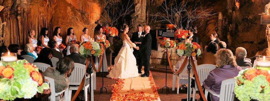 A wedding takes place inside of Luray Caverns Cathedral chamber, home of the Great Stalacpipe Organ.