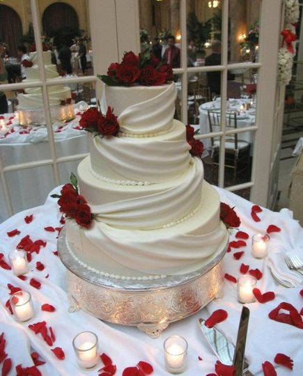 Fondant draping cake with fresh red roses