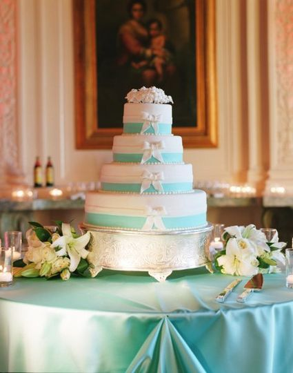 Tiffany blue and white cake with sugar stephanotis on top