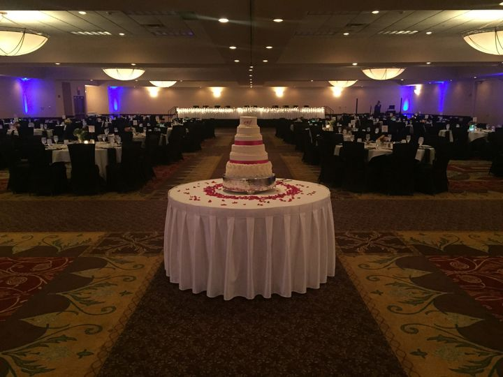 The wedding cake on full display in the ballroom