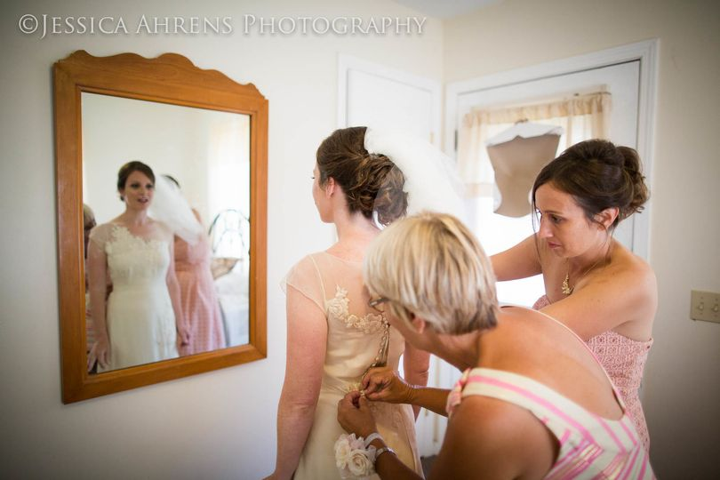 Assisting the bride with her dress