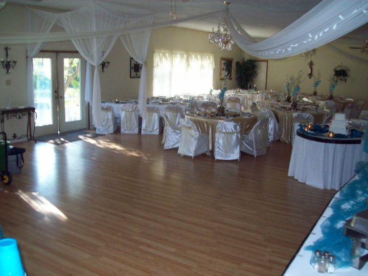 Dance floor with french doors open to a view of the garden area