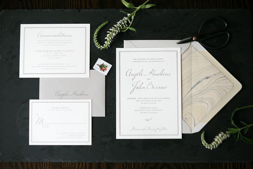 Simple and classic letterpress invitation suite with hand-marbled paper envelope liner.