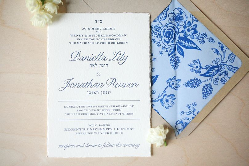 Garden wedding invitation suite in letterpress with deckled edges and floral envelope liner.