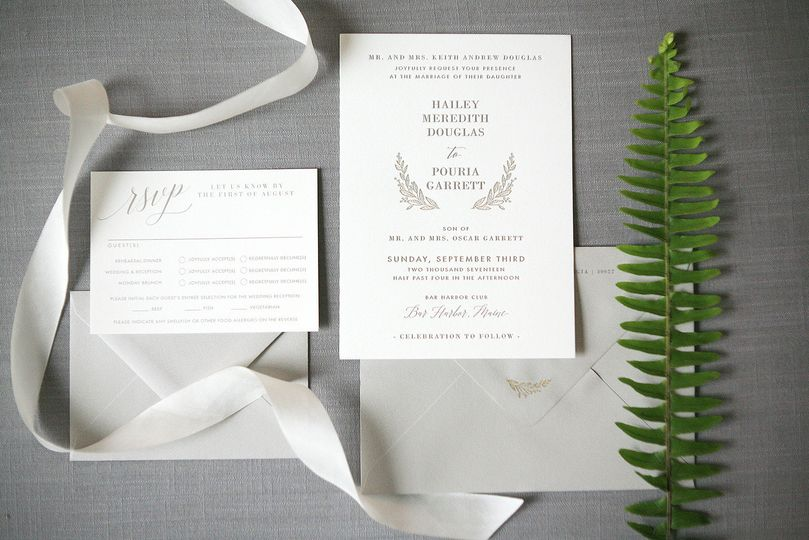 Letterpress invitation suite in gold and grey.
