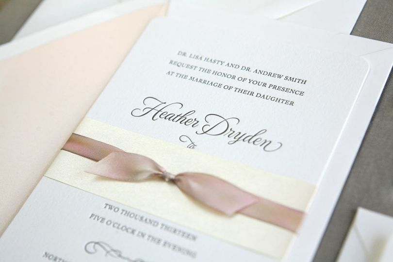 Classic letterpress wedding invitation with hand-dyed silk ribbon.