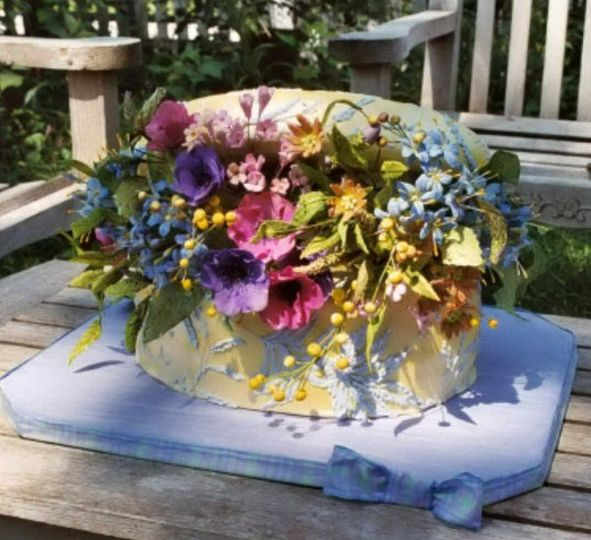Tres magnifique!  A gorgeous Limoges Box cake filled with hand made sugar flowers which is the...