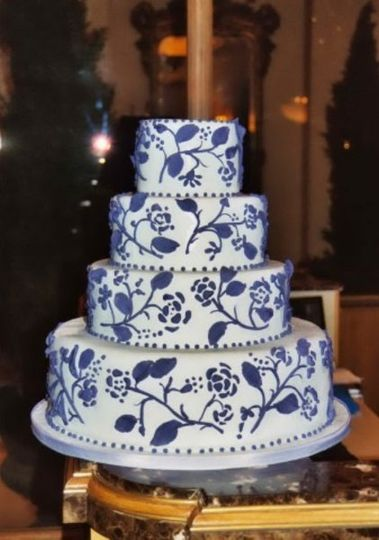 Deep violet plays against the palest shade of azure blue in this exquisite wedding cake.  Decorated...