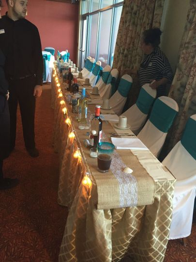 Long table set up with wines