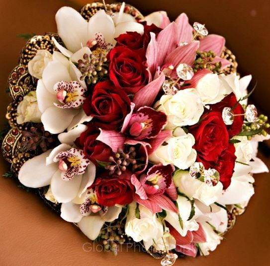 bridal bouquet matched up with brides outfit