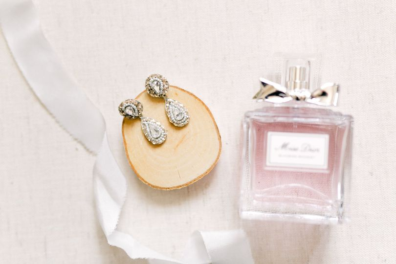 Bride's earrings and perfume