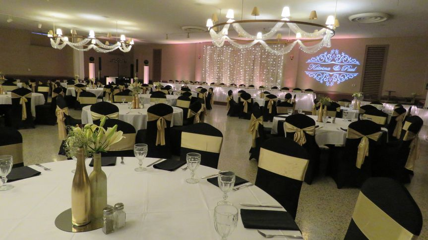 Our ballroom can accommodate 500 guests, lighted tulle backdrop for head table and on chandeliers is...