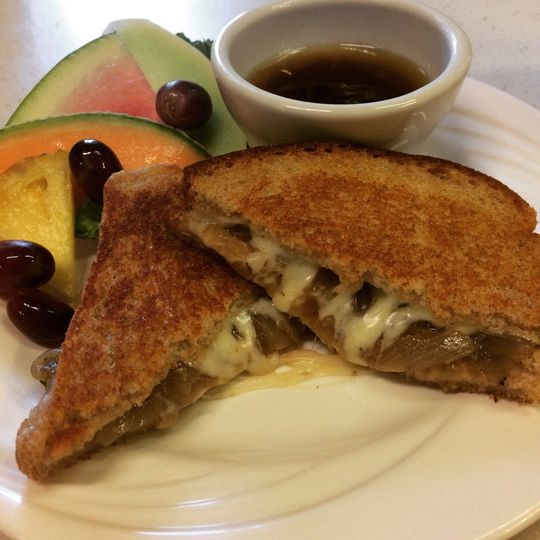 French onion grilled cheese with mozzarella on grilled wheat with a side of French onion soup broth...