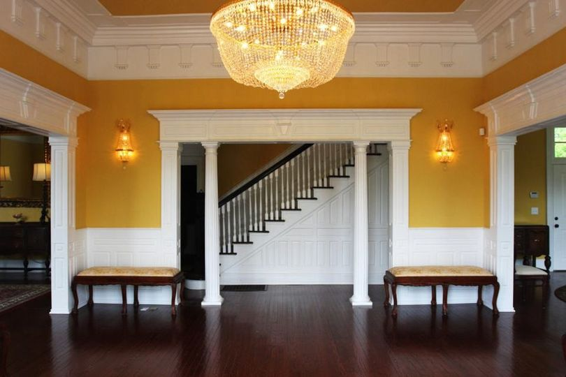 Open the manor's front doors and you've arrived in the grand entry hall - notice the beautiful...