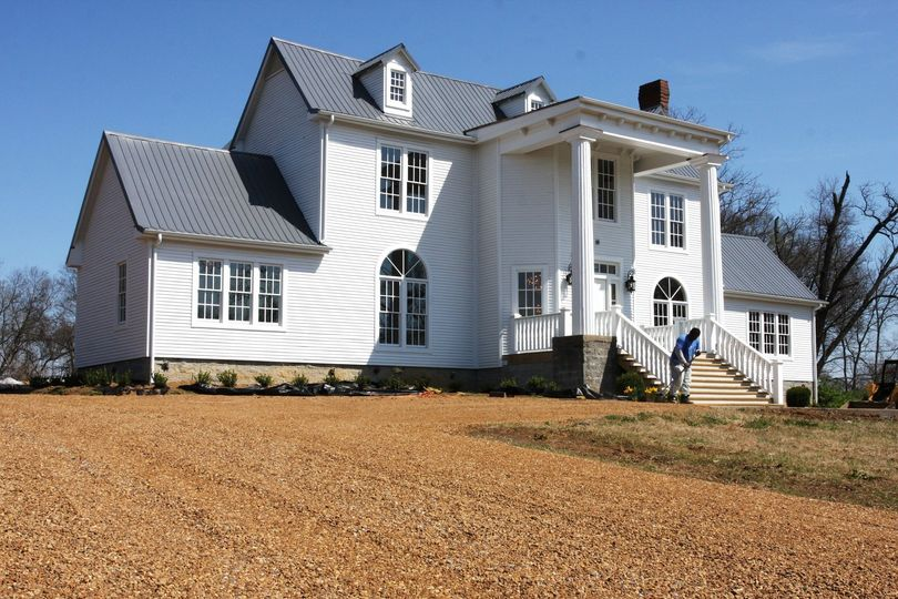 First impression of the historic manor as you pull up the drive with a large front porch inviting...