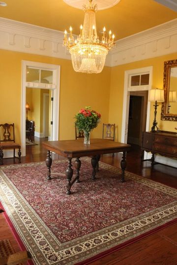 One of many open rooms inside the manor. All house a beautiful crystal chandelier.