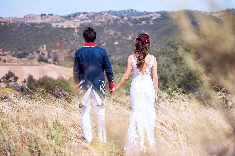 Newlyweds by the fields