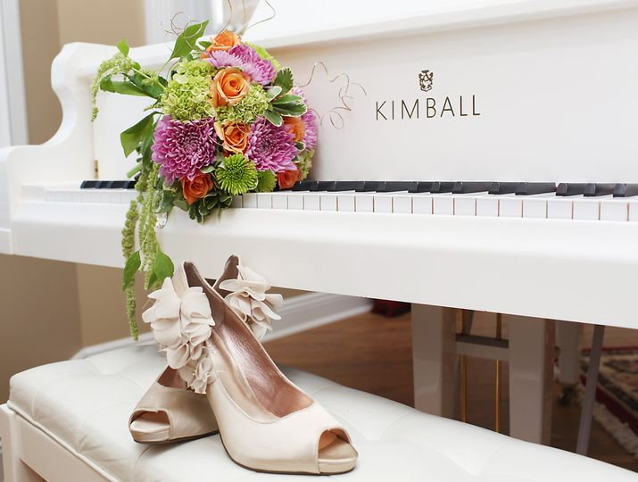 Bridal shoes and flower bouquet