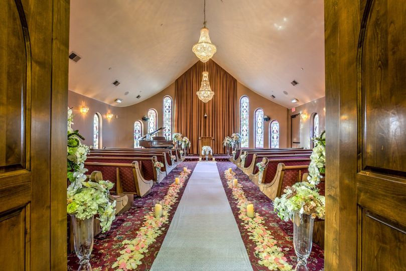 THE Wedding Chapel resembles a traditional chapel complete with custom stained glass windows, a...