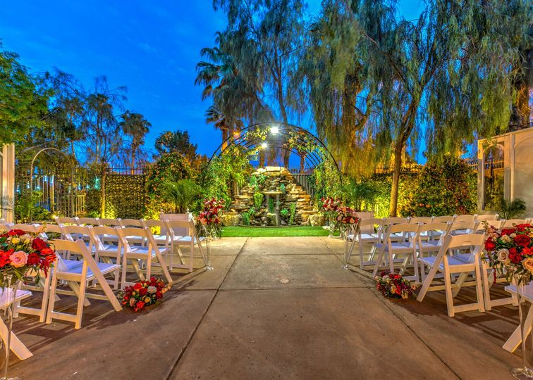 "At the Waterfall Garden, you can stand under an arch of greenery and say ""I do!"" next to a tranquil..."