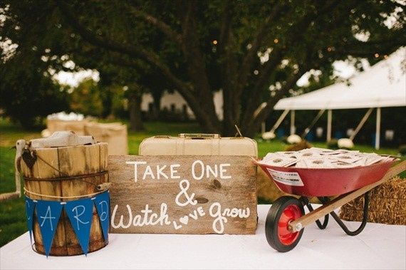 A wheel barrow full of our Personalized or Custom printed Wildflower Seeds to delight your guests!