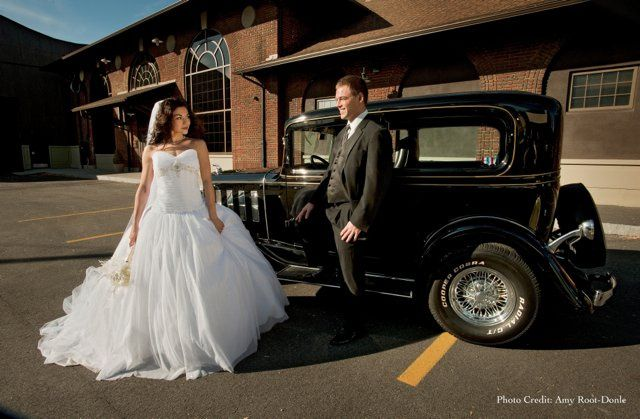 Couples with bridal car