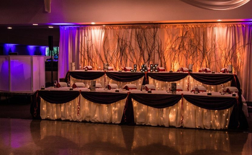 Couple and bridesmaid and groomsmen table area