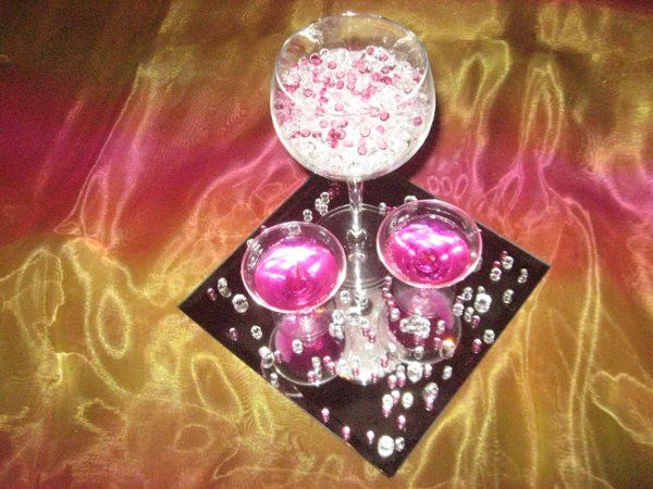 Glitz & Glam table decor.  Sparkly pink & clear crystals atop mirror surface.