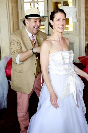the bride and her dress designer Max Chaoul