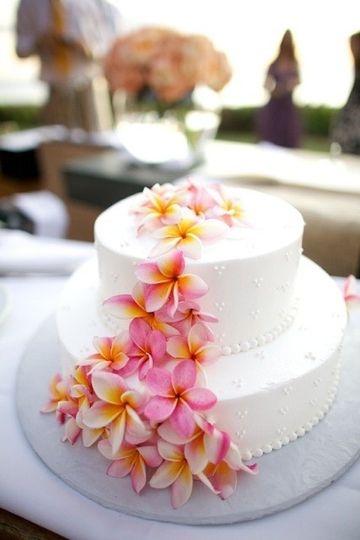 Two tier wedding cake with kalachuchi flowers