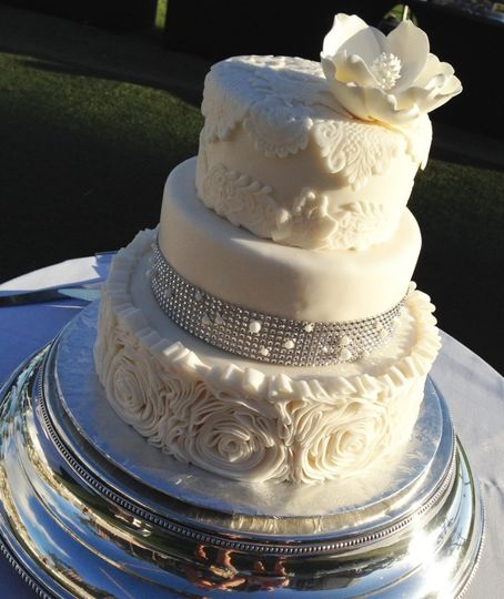 Three tier floral wedding cake