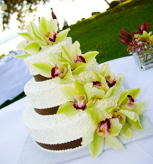 Three tier wedding cake with large flowers