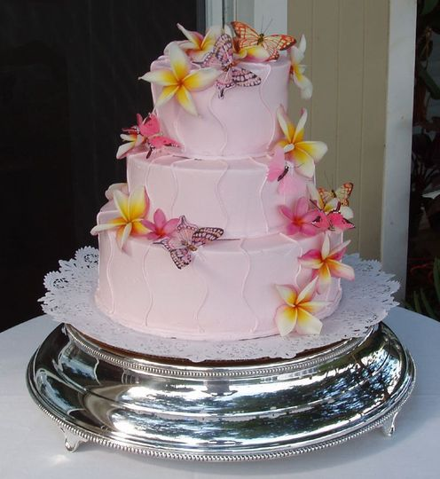 Three tier pink cake with edible kalachuchis