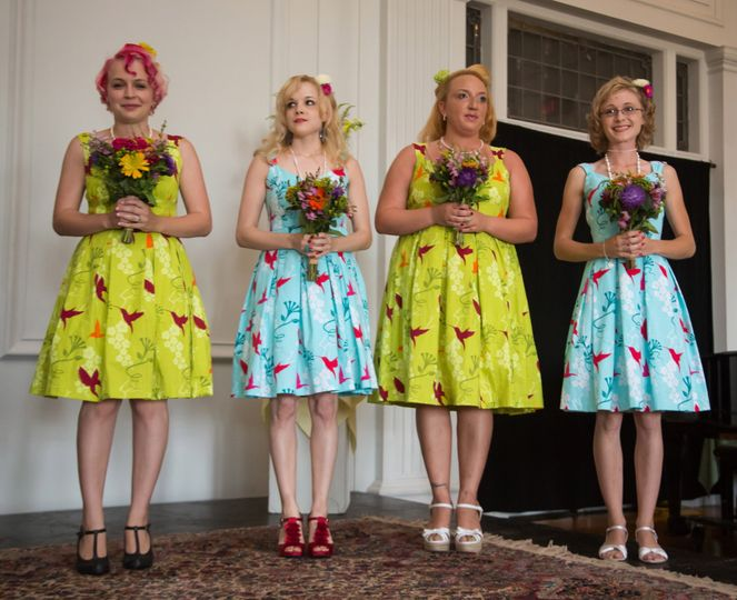 Here are the bridesmaids in cotton print dresses with pleated skirts. Dresses that can truly be worn...