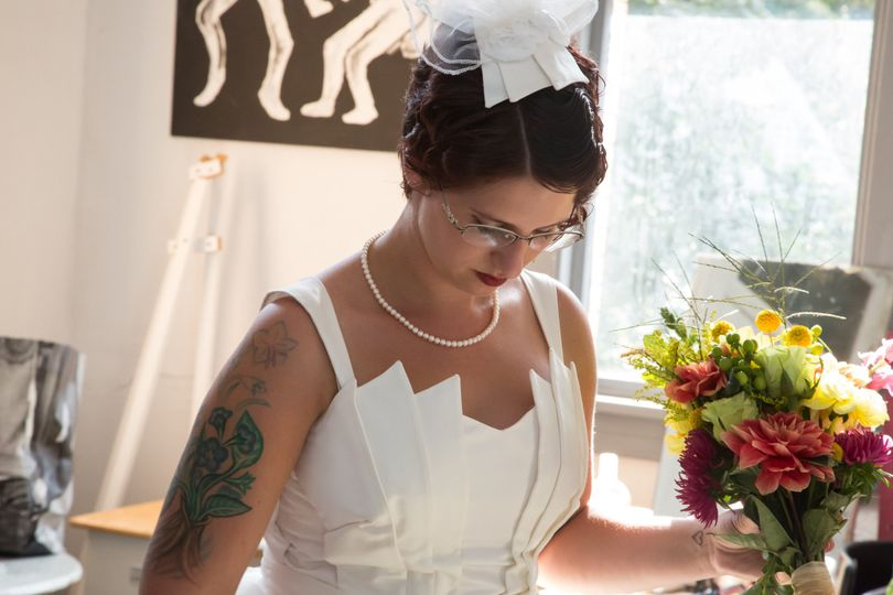 Here is a detail of the bride showing the art deco bodice with shoulder straps. On her head is a...