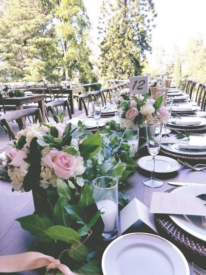 Outdoor reception table and floral centerpiece