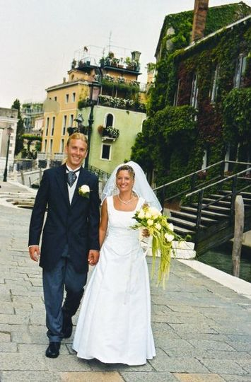 Walking the non auto streets of Venice, Italy after their wedding celebration.