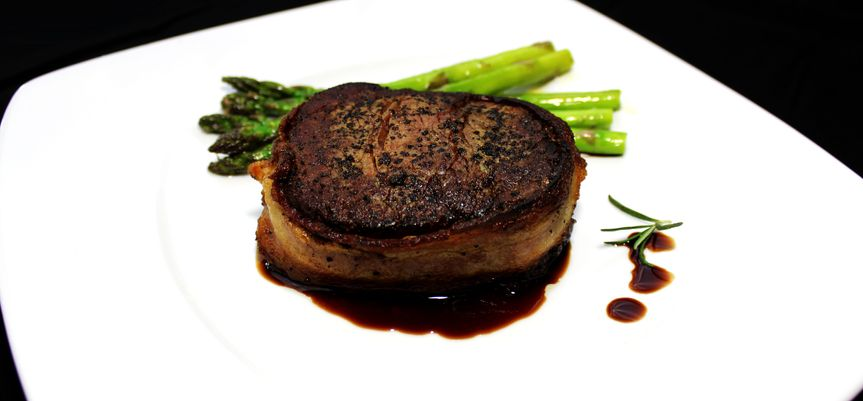 House Filet: bacon wrapped filet mignon with grilled asparagus and our signature cherry demi glace.