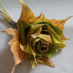 This is made out of fall leaves, perfect for an autumn wedding