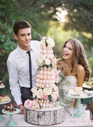 Couple's photo with their wedding cake