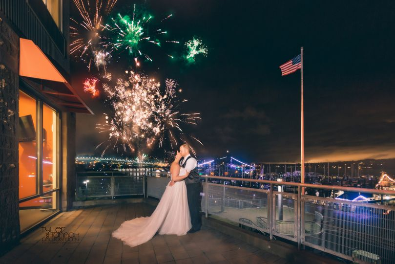 Bride and groom captured during fireworks show