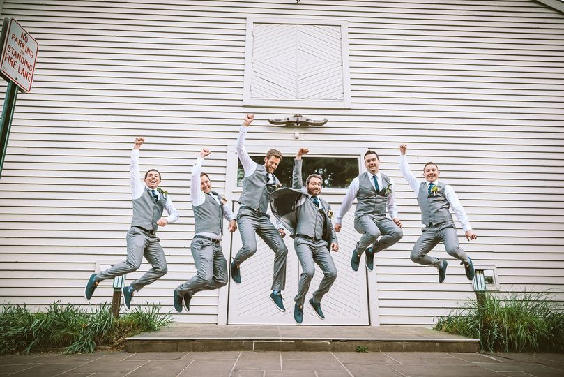 Groom and groomsmen jump shot