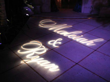 Custom gobo of bride and groom's names at a wedding in Cabo
