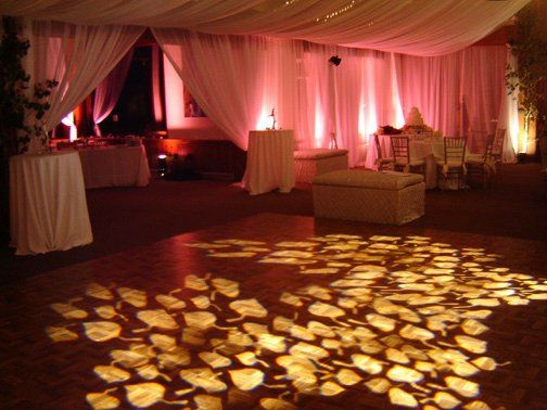 Decorative dancefloor lighting. Custom aspen leaf gobos are very popular for mountain weddings