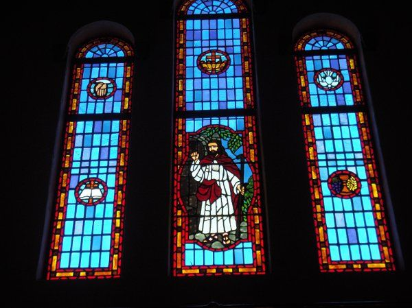 Stained glass windows at the front of the church