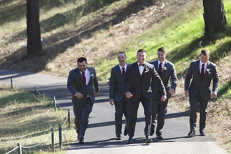 Groomsmen walking to 10th hole