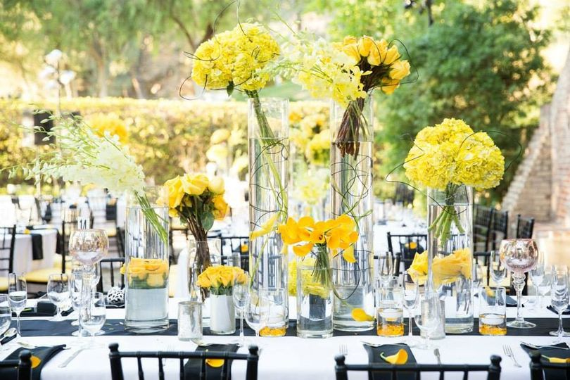 Beautiful outdoor wedding inspired by yellow and black and white theme