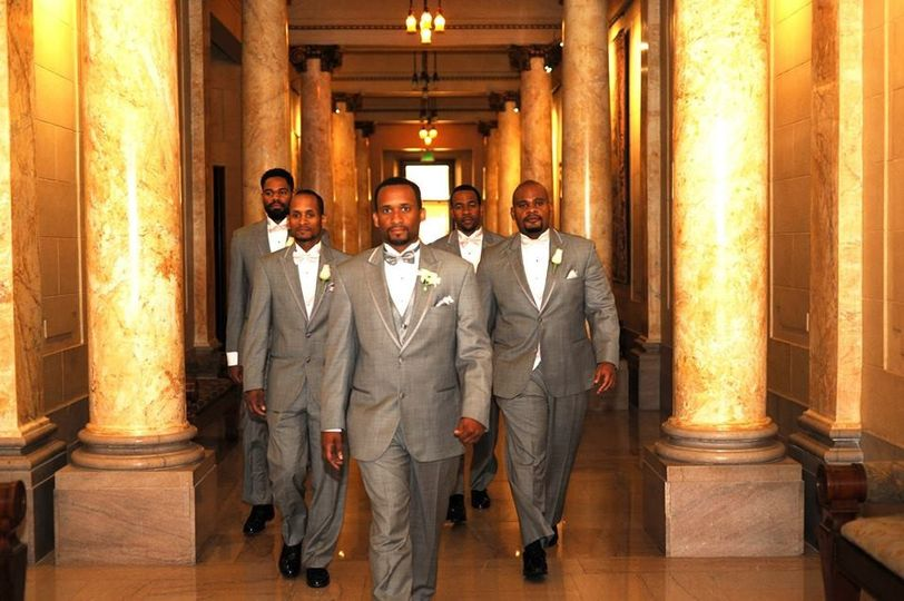 The groom and groomsmen down the 3rd floor collonade.