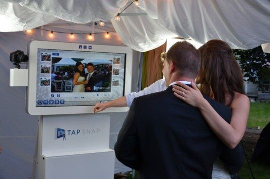 Bride and Grooms love the TapSnap unit.  Add digital props, change the backgrounds, print and sent...