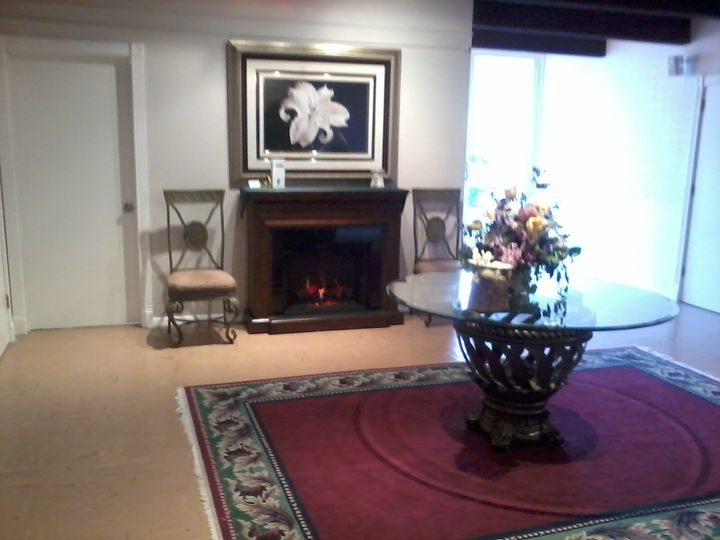 Fireside ambiance in entry way.